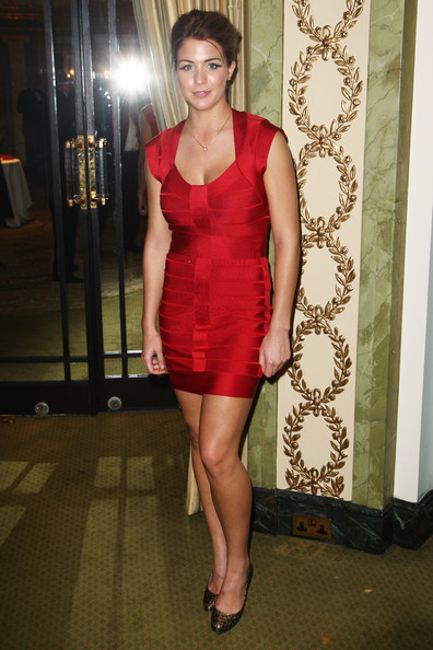 Gemma wore a body-skimming, red bandage dress with a classic updo and printed pumps.