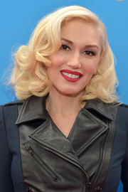 Gwen Stefani complemented her platinum-blonde curls with her signature red lip.