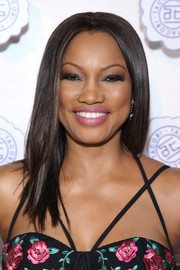 Garcelle Beauvais framed her face with a sleek center-parted 'do for the Tacori in Wonderland event.