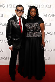 Octavia Spencer showed her love for Tadashi Shoji when she wore his black cap-sleeve gown with a pale pink lace overlay and a belted waist.