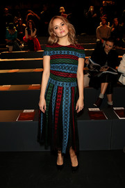 Debby Ryan cut a vibrant figure in a multicolored embroidered dress while attending the Tadashi Shoji fashion show.