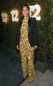 Tracee Ellis Ross arrived for Take-Two's E3 kickoff party looking bright in a yellow print jumpsuit by Marni, which she teamed with a black Alexander McQueen jacket.