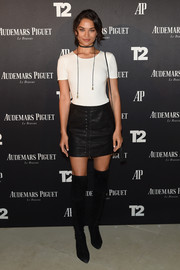 Shanina Shaik kept the sex appeal coming with a black lace-up mini skirt from Blank NYC.