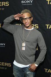 T.I. paired his casual long sleeve with sparkling dog tags.