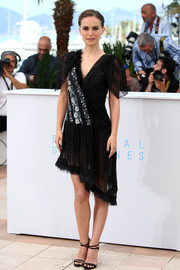 Natalie Portman was in a sassy mood during the photocall for 'A Tale of Love and Darkness,' wearing this Rodarte LBD featuring a sheer, asymmetrical skirt and floral beading on the bodice.