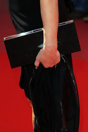Actress Genn Close kept her look simple with a black shimmering box clutch.