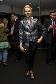 Donna Air paired a sleek metallic blazer with basic black skinny pants for a cool and modern look at the 'CNBC Meets Former President Bill Clinton' screening in London.