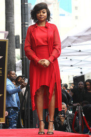 Taraji P. Henson cut a chic figure in a red mesh coat by Akris during her Hollywood Walk of Fame ceremony.