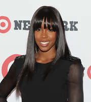 Kelly Rowland walked the red carpet with blunt cut bangs and bone straight locks.