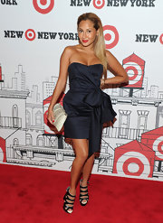 Adrienne looked elegant in a bowed, navy cocktail dress with cutout sandals.