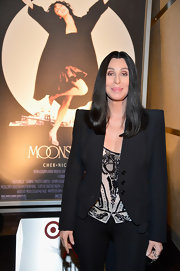 Cher cut a strong silhouette in a black blazer with massive shoulder pads at the AFI's Night at the Movies.