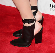 Claire Thomas wore a pair of cool, black ankle booties with an open heel for a sleek and modern look on the red carpet.