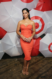 Camila Alves looked gorgeous at the TargetStyle, in Vogue event wearing this strapless red-orange corset dress by Zac Posen that highlighted her figure to perfection.