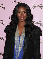 Actress Tasha Smith added some slight curls to her jet black tresses. It looks like she achieved the look with a large curling iron. Those tools work wonders.