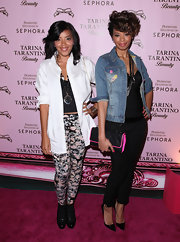 Equally famous, but slightly older daughter Vanessa Simmons donned a black quilted clutch with electric pink details. Nice pop of color.