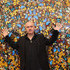 Artist Damien Hirst poses in front of his artwork entitled 'Doorways to the Kingdom of Heaven' in the Tate Modern art gallery on April 2, 2012 in London, England. The Tate Modern is displaying the first major exhibition of Damien Hirst's artworks in the UK, bringing together the collection over 70 of Hirst's works spanning three decades. The exhibition opens to the general public on April 4, 2012 and runs until September 9, 2012.