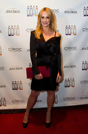 Taylor Armstrong added pop to her black dress with an oversize crimson clutch.