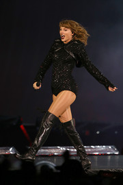 Taylor Swift completed her onstage look with a pair of thigh-high lace-up boots.