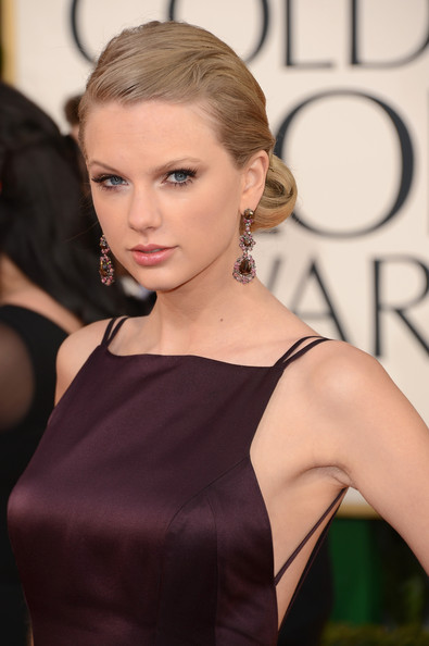 Taylor Swift Chignon [hair,face,hairstyle,shoulder,blond,beauty,fashion model,dress,eyebrow,fashion,arrivals,taylor swift,beverly hills,california,the beverly hilton hotel,golden globe awards]