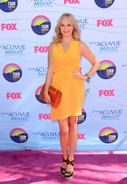 Candice Accola kept it breezy and casual in a sleeveless mustard wrap dress at the 2012 Teen Choice Awards.
