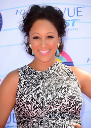 Tamera Mowry added a colorful punch to her ensemble with dangling gold and turquoise earrings at the 2012 Teen Choice Awards.