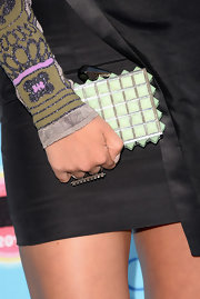 Alexis added some edge to her look with this glowing green studded clutch.