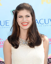 Alexandra Daddario kept her look mod and chic by opting for a half pulled back 'do.