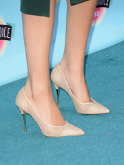 Selena stuck to a class with these closed-toe lace pumps.