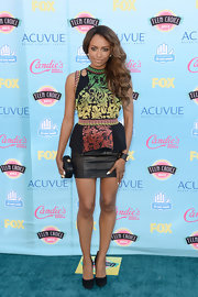 Kat chose this colorful brocade peplum top to go with a leather skirt for her bold and sexy blue carpet look.