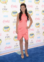 Madalyn Horcher went for modern sophistication at the Teen Choice Awards in a pink cocktail dress with a crisscross bodice and a wrap-style skirt.