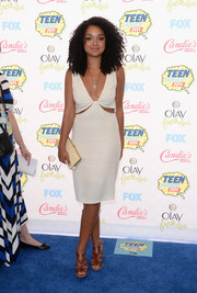 Aisha Dee flashed some skin in a deep-V white cutout dress at the Teen Choice Awards.
