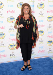 Abby Lee Miller chose a pair of strappy black wedges to complete her outfit.