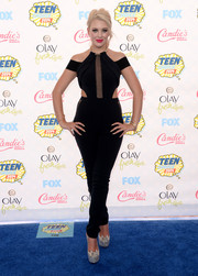 Hailey Reese worked the Teen Choice Awards blue carpet in an edgy-sexy black jumpsuit with side cutouts and a mesh panel down the bodice.