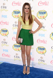 Laura Marano did some cute color blocking with this green mini and yellow top combo.