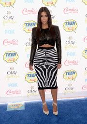 Kim Kardashian looked very curvy in her black-and-white zebra-print pencil skirt, also by Balmain.