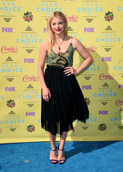 Chloe Grace Moretz pulled her outfit together with a pair of purple ankle-strap sandals by Casadei.