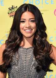 Gina Rodriguez left her hair down with a center part and lush waves for her Teen Choice Awards look.