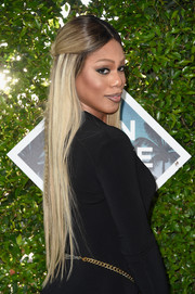 Laverne Cox topped off her look with a sleek half-up hairstyle when she attended the Teen Choice Awards 2016.