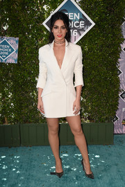 Emeraude Toubia looked impeccable in a white Rosita Hurtado tuxedo dress at the Teen Choice Awards 2016.