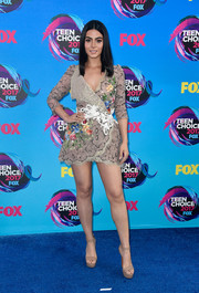 Emeraude Toubia showed an eyeful of leg in this embroidered wrap dress by Nicolas Jebran at the 2017 Teen Choice Awards.