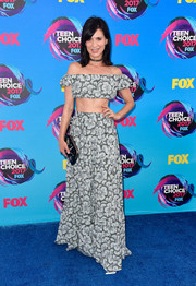 Perrey Reeves accessorized her look with a cosmic-embroidered frame clutch.