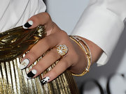 Zendaya Coleman had a lot of things going on with her nail art! A little bit of Chanel mixed with some abstract designs made for one chic hand.