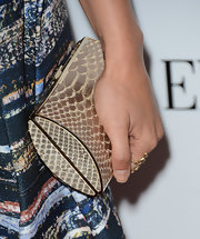 Jessica Lowndes' metallic snakeskin clutch was a nice contrast to the dark abstract print of her dress.