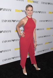 Sadie Calvano looked perky in a bright red halter jumpsuit by BCBGeneration at the Teen Vogue Young Hollywood Issue party.