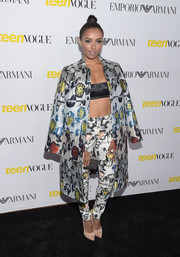 Kat Graham turned heads in her Opening Ceremony printed coat and pants combo teamed with a skimpy Versace bandeau top at the Teen Vogue Young Hollywood Issue party.