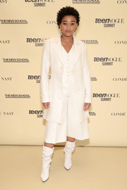 Amandla Stenberg rounded out her look with a pair of slouchy white boots.