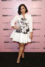 Demi Lovato made an appearance at the 2019 Teen Vogue Summit wearing a printed white shirtdress by Valentino.