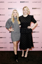 Florence Pugh donned a gray plaid mini dress with puffed sleeves for the 2019 Teen Vogue Summit.
