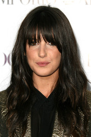 Shenae Grimes looked mysterious with her eye-grazing bangs and long wavy cut at the Teen Vogue Young Hollywood party.