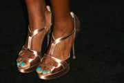 Tolula Adeyemi wore an elegant pair of gold satin platform sandals (and bright turquoise nail polish) at the Teen Vogue Young Hollywood party.